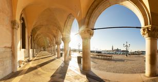 Palace of Doges, Venice, Italy. Palace of Doges details - arches of open galley and embanlment with spring sunshine, Venice, Italy royalty free stock photos