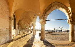 Palace of Doges, Venice, Italy. Palace of Doges details - row of arches and embanlment with spring sunshine, Venice, Italy stock image