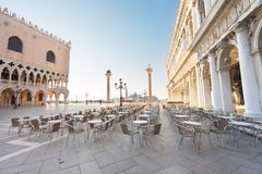 Palace of Doges, Venice, Italy. Palace of Doges facade detail and cafe of San Marco square, Venice, Italy stock image