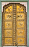 Palace door. Beautiful brass metal palace door with floral designs engraved Royalty Free Stock Image