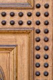 Palace door fragment. Light wooden palace door fragment Royalty Free Stock Images