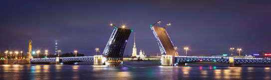 Palace drawbridge in Saint Petersburg. Opening of Palace drawbridge, White nights in Saint Petersburg, view of Peter and Paul Cathedral through the bridge Stock Image