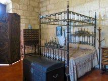 Ducal Palace of Braganca in Guimaraes. Bedroom in the Palace of the Dukes of Braganza in Guimaraes, Portugal Royalty Free Stock Photos