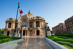 Palace of fine arts facade and Mexican flag Royalty Free Stock Image