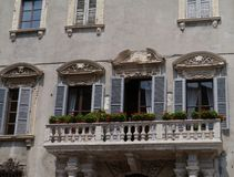 A palace with flowers in the old center of Verona Stock Image