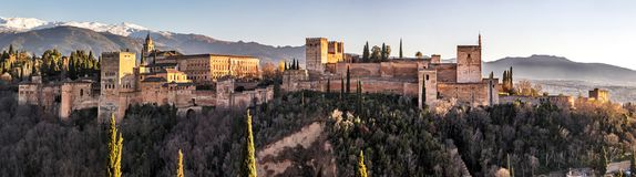 Palace and fortress complex Alhambra. With Comares Tower, Palacios Nazaries and Palace of Charles V during sunset in Granada, Andalusia, Spain Stock Image