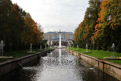 Palace and fountains. Palace and channel with fountains in the fall Stock Photos