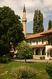 Palace garden. The green garden, house and minaret in ancient palace in Bakhchisarai Stock Photo