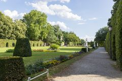 Palace garden in front of the Prince-elector Palace in the center of Trier. Trier, Germany - July 06, 2018: Palace garden in front of the Prince-elector Palace royalty free stock image
