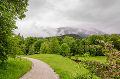 Palace garden of Linderhof Castle on the background alps in Bavaria, Germany.  Royalty Free Stock Image