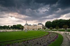 Palace garden view. The French Senate palace in the Luxembourg park at sunset Stock Photos