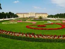 Schonbrunn Palace in Vienna, Austria. Vienna, Austria -  Beautiful  view  of  flowering   garden in a sunny day  in front  of  the Schonbrunn  Palace , the Stock Image