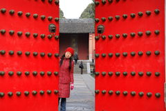 Palace gate of Ming tomb in Nanjing. A woman in red at Palace gate of Ming tomb in Nanjing royalty free stock photos