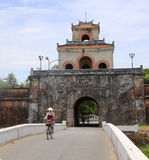 The Palace gate to the Hue Citadel with cyclist Royalty Free Stock Image