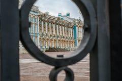 Palace through the gates in Tsarskoe Selo, Pushkin, Saint Peters. Palace through the gates in Tsarskoe Selo, Pushkin,  Saint Petersburg Stock Photo