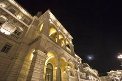 Palace of the Government. Night view of the Palace of Government of the city of Trieste, with the moon in the background Royalty Free Stock Images