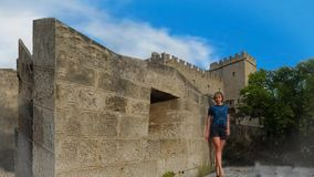 The Palace of the Grand Masters. A woman stands during the tour in the Palace of the Grand masters. The Island Of Rhodes, Greece stock video