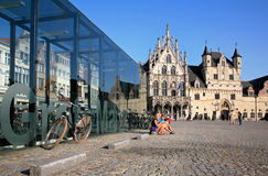 Palace of the Great Council (left) and the cloth hall with its u. Mechelen Town Hall is actually two buildings: the cloth hall with its unfinished belfry ( royalty free stock photo