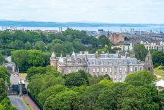 Skyline of edinburgh and holyrood house palace. The Palace of Holyroodhouse commonly referred to as Holyrood Palace, is the official residence of the British stock photography
