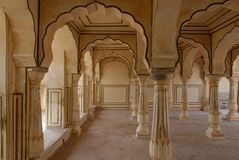 Palace Interiors. The wooden arches in the interiors of an old Indian palace Royalty Free Stock Photography