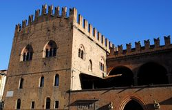 Palace of King Enzo lit by the morning sun in the city center in Bologna in Emilia Romagna (Italy) Royalty Free Stock Photos