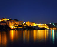 Palace on lake in Udaipur India at night Royalty Free Stock Photos