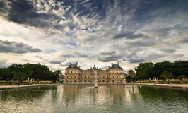 Palace with lake view. HDR image of the French Senate palace in the Luxembourg park, near sunset Royalty Free Stock Photo