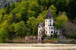 Palace on the lake. View of Villa Castiglioni, built by an Austro-Hungarian aristocrat. Palace is located in the beautiful Salzkammergut region royalty free stock photo