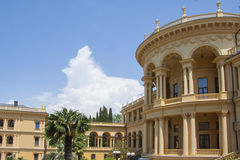 Palace landscaping. Beautiful villa in ancient greek classic style with landscaped green territory; outdoor panorama with copy space royalty free stock photography