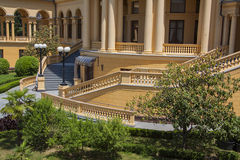 Palace landscaping. Beautiful villa in ancient greek classic style with landscaped green territory; outdoor panorama with copy space stock photos