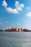 The palace in Lithuania on the picturesque lake. Stock Image