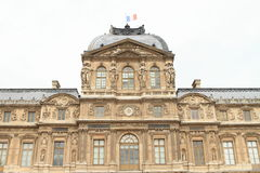 Palace Louvre. With French flag on historic building (Paris, France Royalty Free Stock Images