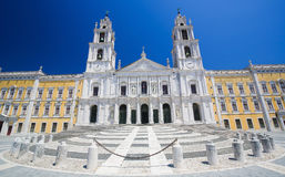 Palace of Mafra, Portugal. Facade of the Basilica at the Palace of Mafra, Portugal, a famous royal palace built in the 18th Century Royalty Free Stock Images
