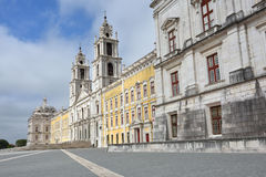 Palace of Mafra Portugal. Facade of the Basilica at the Palace of Mafra Portugal a famous royal palace built in the 18th Century Stock Image