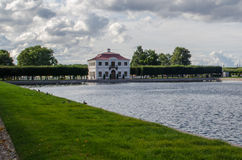 Palace of the Marli in Petrodvorets. View of the pond and the Marly Palace in Petrodvorets near St. Petersburg Royalty Free Stock Photography