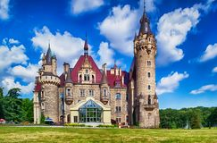 Palace in Moszna, Poland. Fairytale historic palace with 99 towers, Moszna village, Poland royalty free stock photo