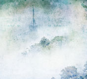 Palace mountain mist. Fairytale castle in mist above woodland Royalty Free Stock Photo