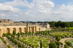 Palace and park ensemble in France. Royal castle with beautiful gardens and fountains stock photos
