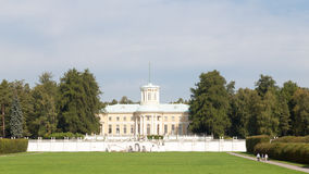 Palace, the park, and people walk Royalty Free Stock Image