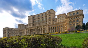 The Palace of the Parliament - Landmark attraction in Bucharest, Romania. Spring landscape Stock Images