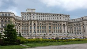 Palace of the Parliament. Is located in Bucharest, the capital of Romania.  Image taken with a Samsung S4 mobile phone in a cloudy day of summer Stock Image