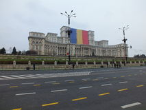 The palace of the parliament with national flag Stock Photo