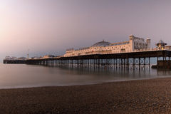Palace Pier. Brighton`s Palace pier in the early morning sun, slow shutter speed to blur the water Royalty Free Stock Image