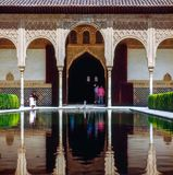 Palace with pool in Alhambra,Spain. Pool in Alhambra, Granada, Spain royalty free stock photos