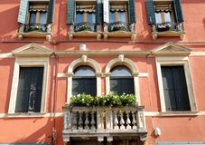 Palace red with flowered balcony in Veneto (Italy). Photo made in Monselice ancient medieval village that is located in the park of the hills Hills in the Stock Images
