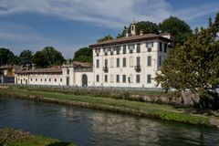 Palace on the riverbank in Cassinetta di Lugagnano royalty free stock photo
