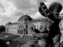 Palace and sculpture. Two angels in front of Wuerzburgs palace Stock Image