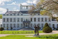 Palace soestdijk in Baarn, The Netherlands. The previous residence of the royal dutch family with the statue of Queen Juliana and Prince Bernhard in the garden Stock Image