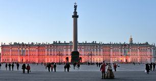 Palace Square and the Alexander Column in front of the Hermitage in St. Petersburg. In the evening Royalty Free Stock Photo