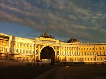 Palace Square(Dvortsovaya Ploshchad) in a white night. Palace Square is the main square of St. Petersburg, the architectural ensemble. The sun illuminates the Stock Photo